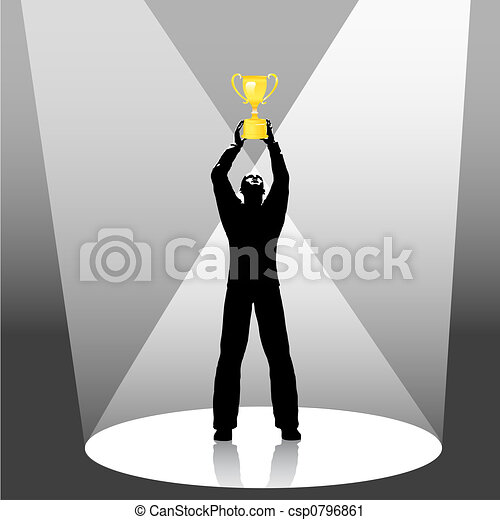 person holds trophy up in spotlight - csp0796861