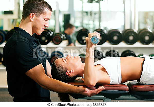 Personal Trainer in gym - csp4326727