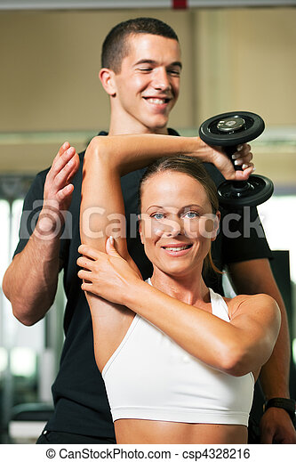 Personal Trainer in gym - csp4328216