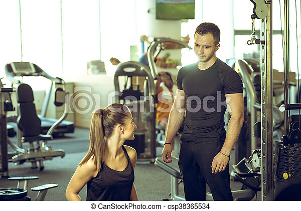 74997fc87fc Personal trainer talks to his client. Young male personal fitness ...