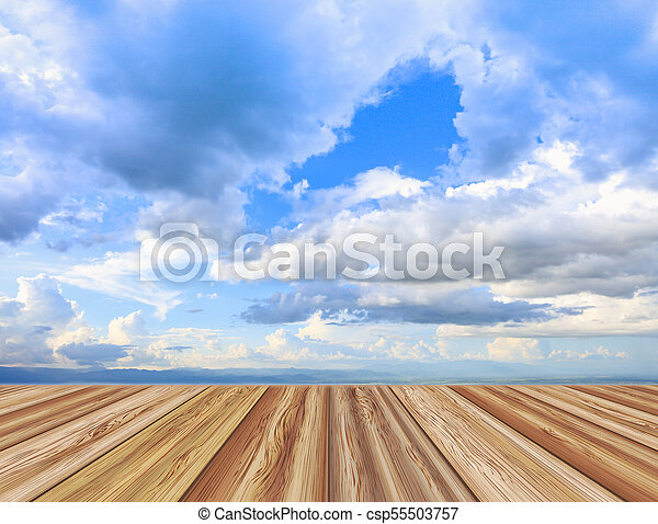 Perspective wooden board empty table top over beautiful blue sky with  cloudy