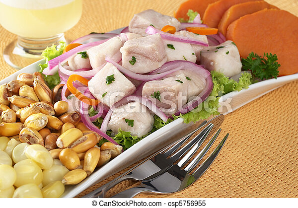 Peruvian-style ceviche made out of raw dogfish (Spanish: tollo), red onions and aji (Peruvian hot pepper) and served with corn, roasted corn (cancha) and sweet potato with Pisco Sour (Peruvian traditi - csp5756955
