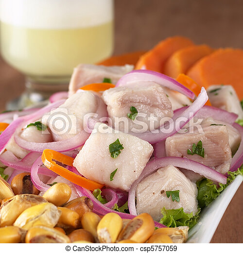 Peruvian-style ceviche made out of raw dogfish (Spanish: tollo), red onions and aji (Peruvian hot pepper) and served with roasted corn (cancha) and sweet potato with Pisco Sour (Peruvian traditional c - csp5757059