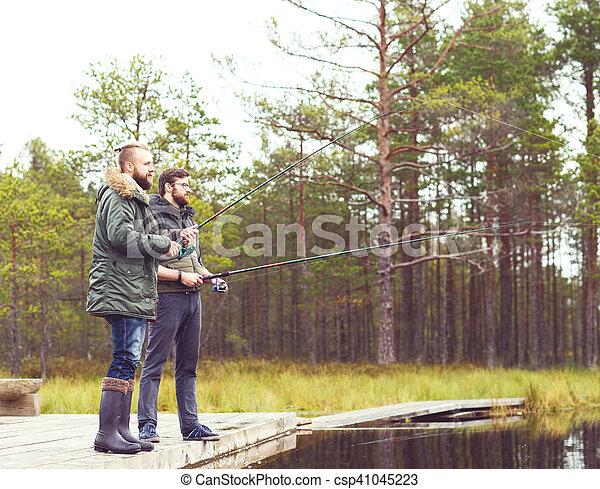 Pescadores con hiladores atrapando peces - csp41045223
