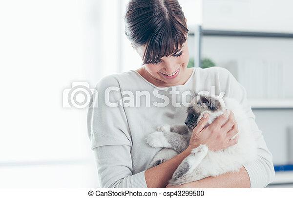 Pet owner with her cat - csp43299500