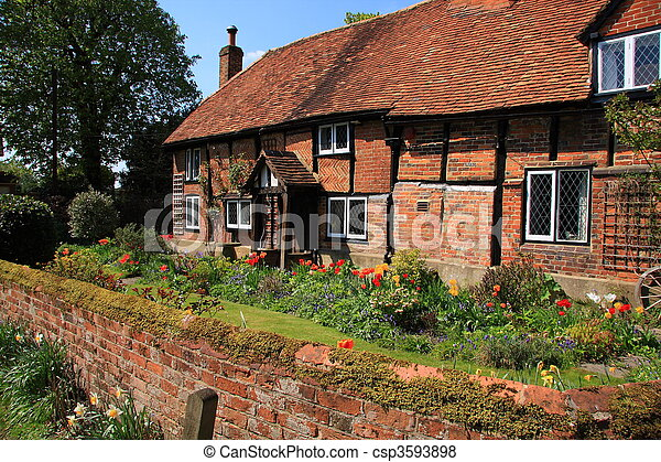 Petite maison brique moyen ge bois construction fleur for Petite maison construction