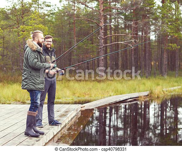Pescadores con una caña de pescar en un río - csp40798331