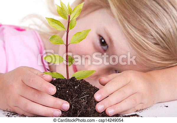 Kind mit Pflanze lächeln - csp14249054