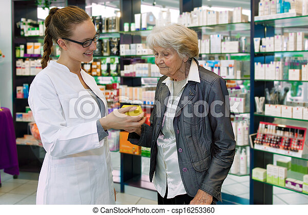 Pharmacist advising medication to senior patient - csp16253360