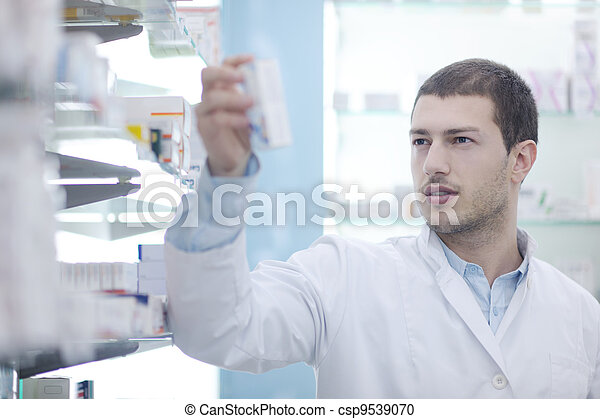 pharmacist chemist man in pharmacy drugstore - csp9539070