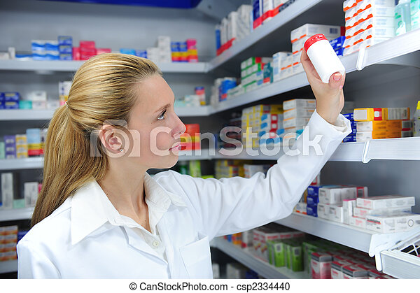 pharmacist searching the right medicine - csp2334440