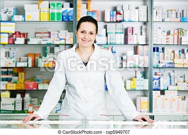 Pharmacy chemist woman in drugstore - csp5949707