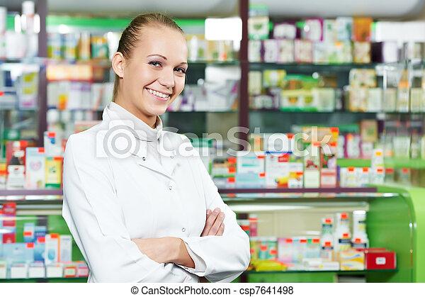 Pharmacy chemist woman in drugstore - csp7641498