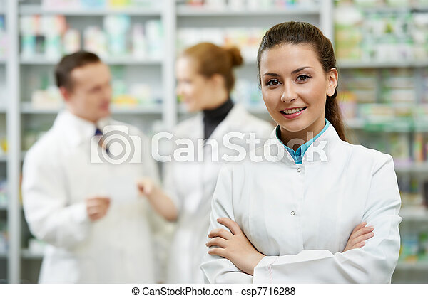 Pharmacy chemist woman in drugstore - csp7716288