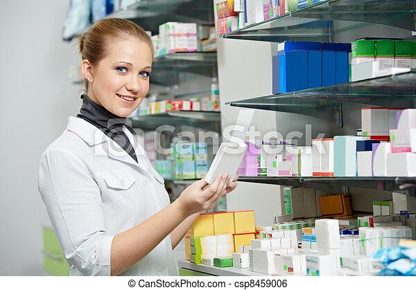 Pharmacy chemist women in drugstore - csp8459006