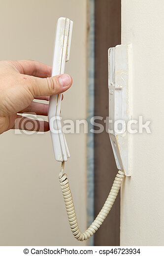 phone attached to the wall - csp46723934