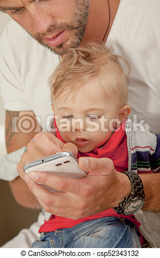 Phone Baby Interest Technology Father Showing - csp52343132