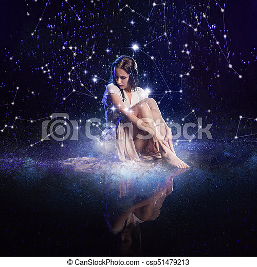 Photo art, young woman dreams to starry sky. Elements of this image furnished by NASA. - csp51479213