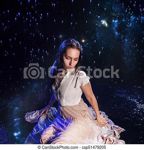 Photo art, young woman dreams to starry sky. Elements of this image furnished by NASA. - csp51479205