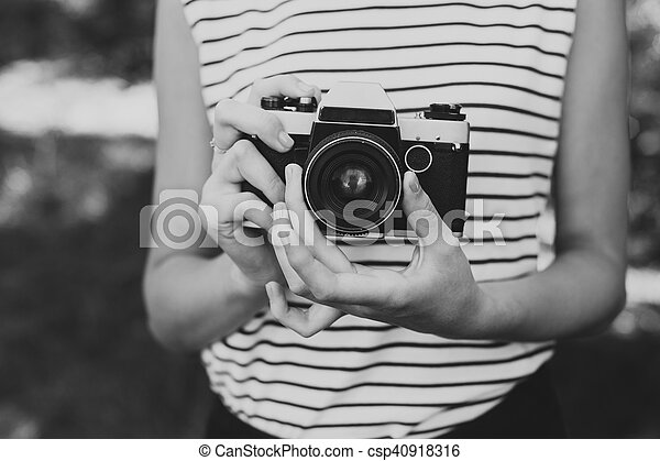 Photo camera in the hands of the girl - csp40918316
