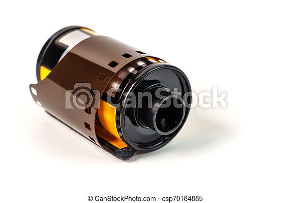 Photo film in cartridge isolated on white. Photographic film in - csp70184885