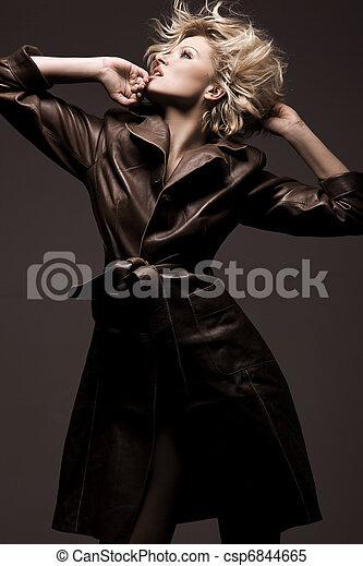 Photo of a beauty woman wearing coat - csp6844665