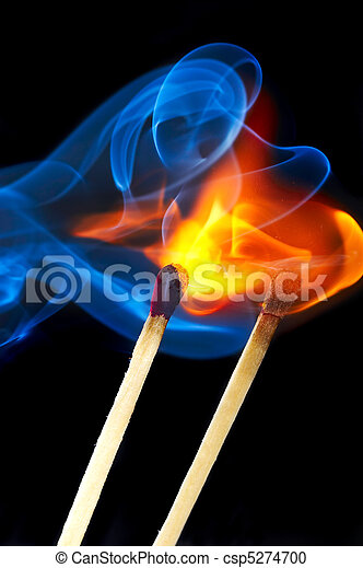 Photo of a burning match in a smoke on a black background - csp5274700