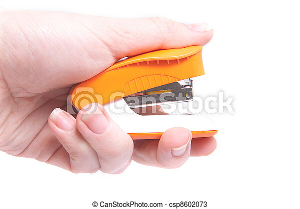 photo of a stapler in the hand - csp8602073