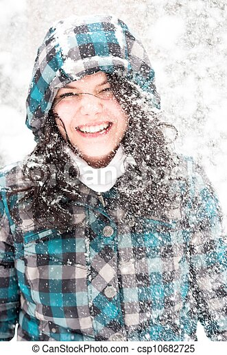 Photo of a young woman in the snow - csp10682725