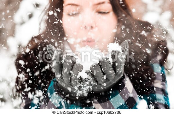 Photo of a young woman in the snow - csp10682706