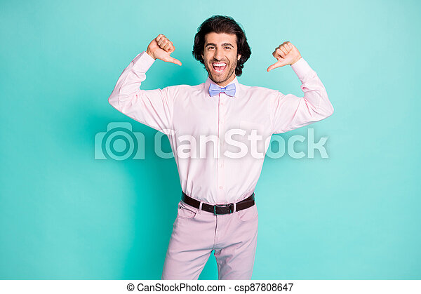 Photo of cheerful good mood wavy hair man wear pink outfit pointing himself two thumbs fingers isolated teal color background - csp87808647