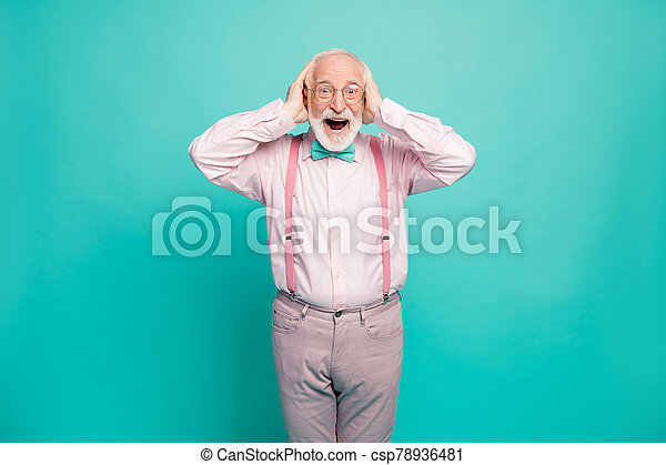 Photo of crazy grandpa positive expression arms on head good mood addicted shopper wear specs pink shirt suspenders bow tie pants isolated bright teal color background - csp78936481