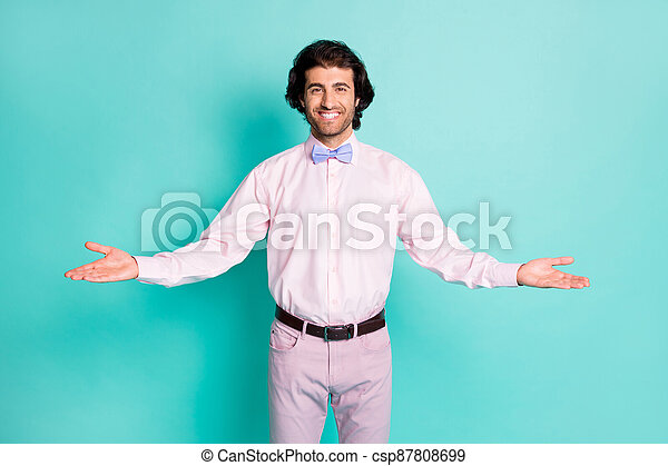 Photo of cute charming brunet wavy hair man dressed pink outfit welcome you open arms isolated teal color background - csp87808699