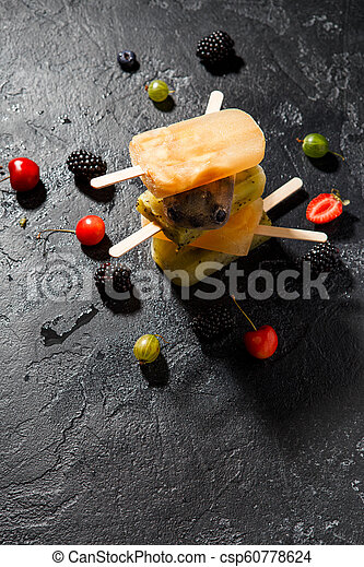 Photo of frozen fruit juice on top of each other and berries - csp60778624