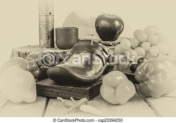 Photo of fruit and vegetables on old vintage table - csp23394250