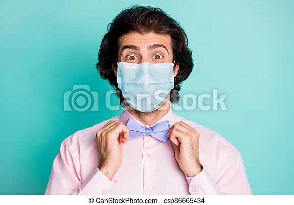Photo of handsome cute boyfriend wear pink medical mask two arms fix bow tie isolated teal color background - csp86665434