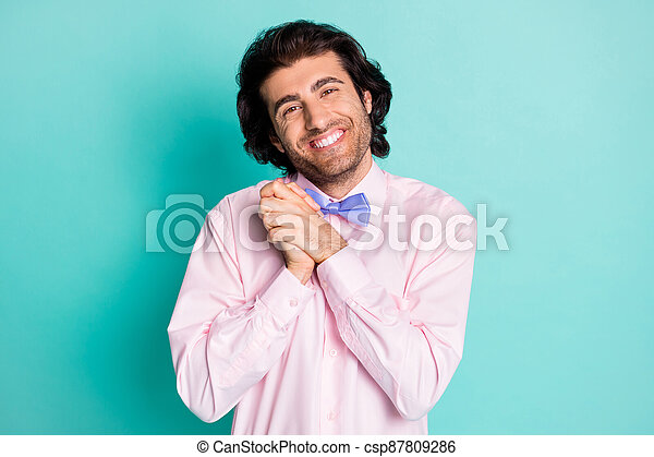 Photo of handsome cute guy wear pink outfit being touched by you two arms together isolated teal color background - csp87809286