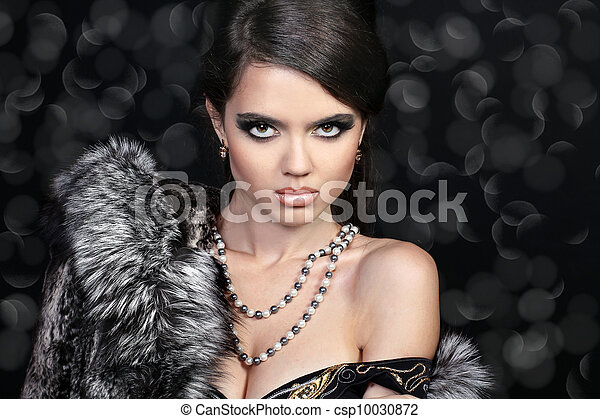 Photo of sexual beautiful girl is in fashion style, fur coat - csp10030872