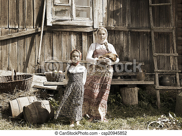 Photo of sisters in farm - csp20945852