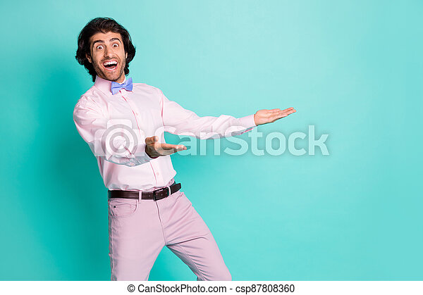 Photo of surprised bristle curly man dressed pink outfit open mouth open arms isolated turquoise color background - csp87808360