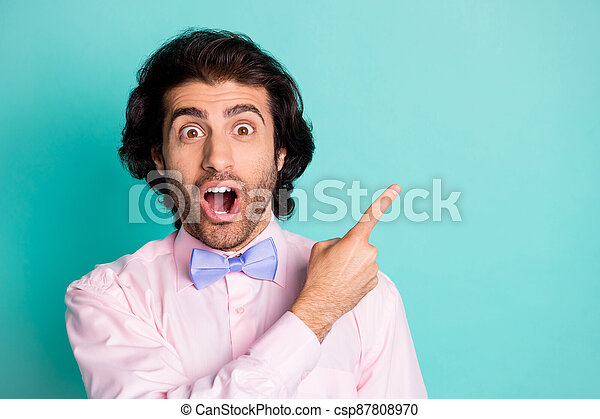 Photo of surprised cute funny boyfriend wear pink outfit pointing empty space open mouth isolated teal color background - csp87808970