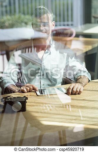 Photographer at the bar - csp45920719