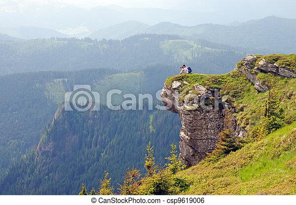 Photographer on a huge rock - csp9619006