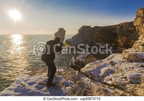Photographer on the rocks - csp50873710