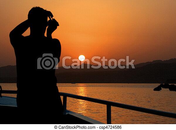 Photographer on the Yacht. Sea Sunset - csp4724586