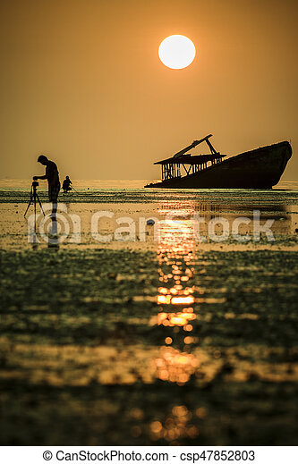 photographer taking a photography of abandon wreck boat in phuket southern thailand - csp47852803