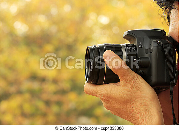 Photographer Taking A Shoot With A Digital Camera - csp4833388