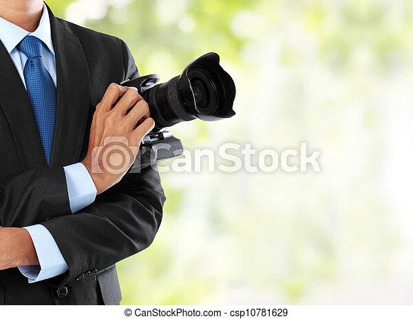 photographer with dslr camera - csp10781629