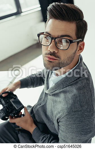 photographer with photo camera - csp51645026