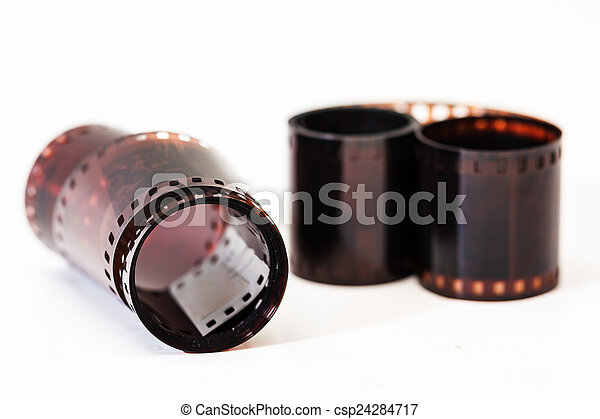 Photographic film. Film reel on white. - csp24284717
